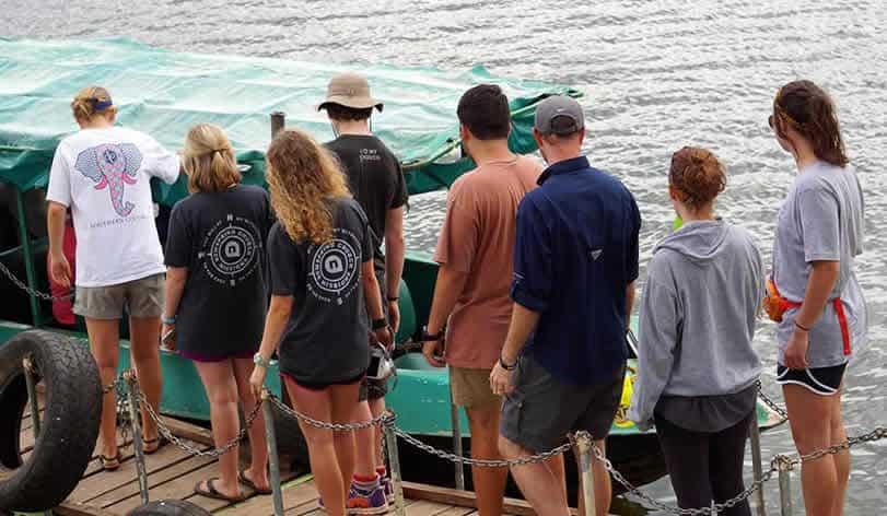 Group of tourist taking a boat safari in lake mburo national park